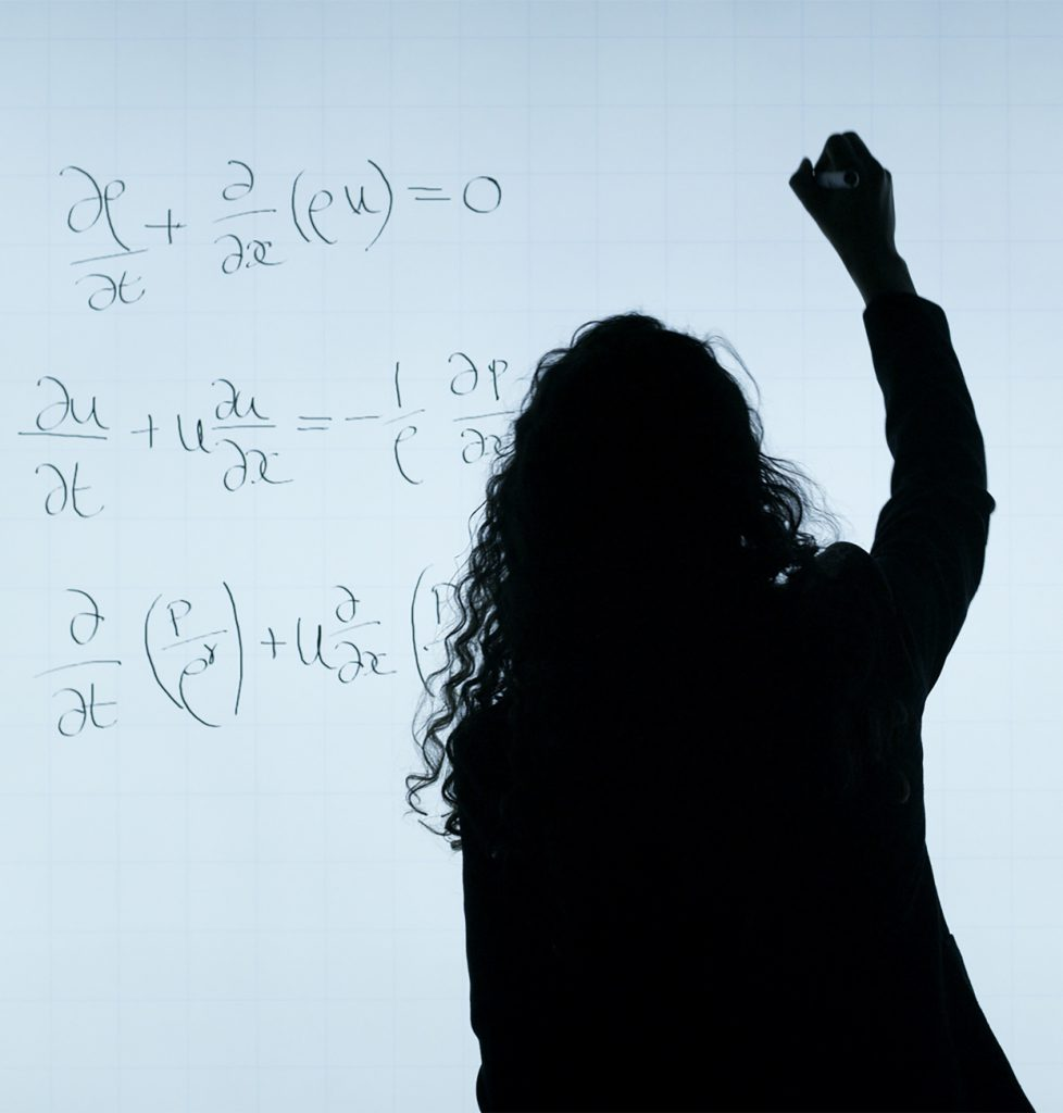 Woman writing math on a whiteboard