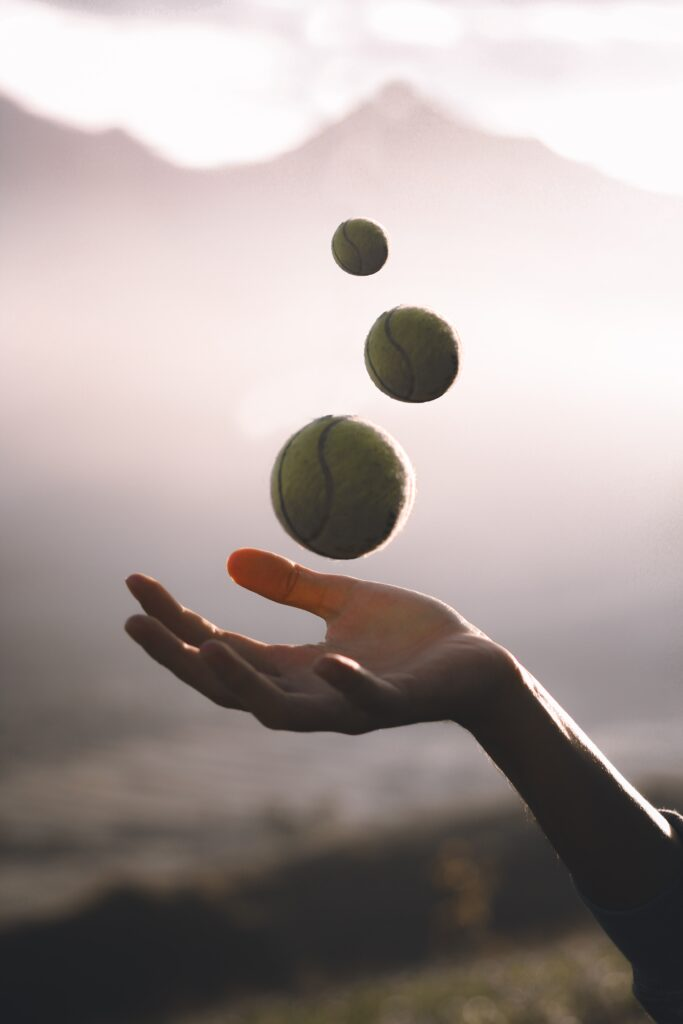 Juggling tennis balls